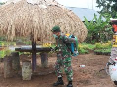 Mencegah Covid-19, TNI-Polri Semprotkan Disinfektan di Perbatasan RI-Papua New Guinea